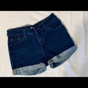 BDG urban outfitter dark blue shorts .